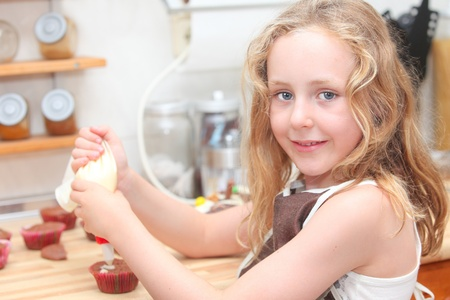 chocolate cupcakes: child cooking and helping decorate cupcakes