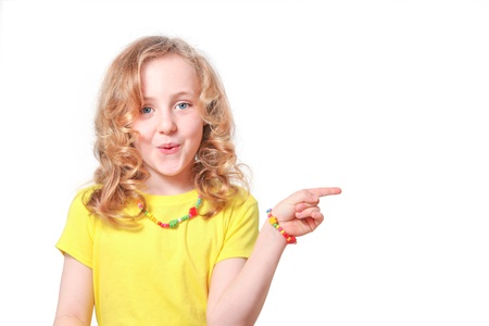 surprised Girl child pointing to blank copy space (your product)