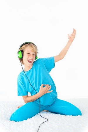air guitar: young teen kid playing air guitar and listening to music Stock Photo