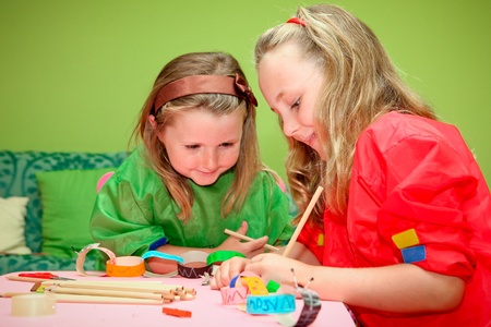 crafts person: happy smiling children playing drawing and making craft in class at kindergarden school Stock Photo