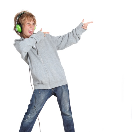 cool boy: Kid pointing and listening to music