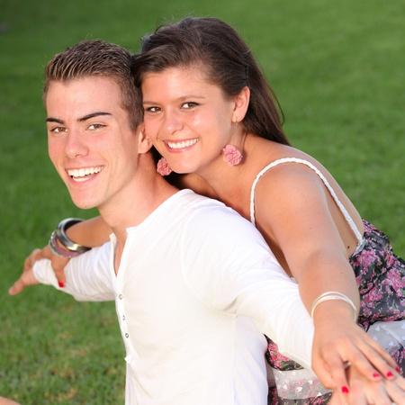 happy piggyback couple with perfect smiles Stock Photo - 10783190