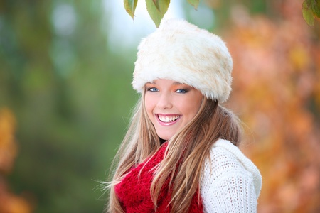 happy smiling autumn woman with fur hat photo