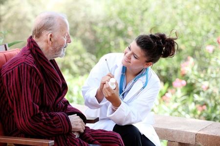 senior man with doctor or nurse photo