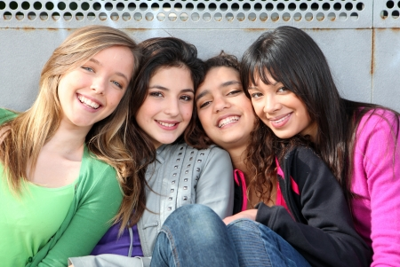 diverse teens: mixed race group of smiling girls