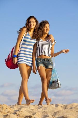 happy teens on beach vacation or spring break photo