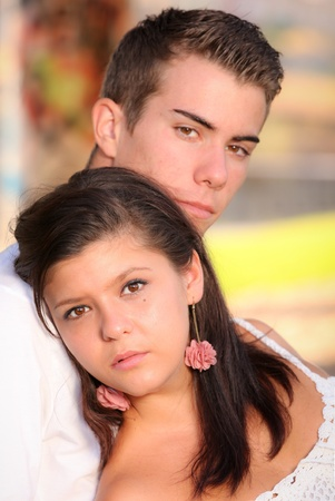 teenage couple: young couple with serious sad unhappy faces
