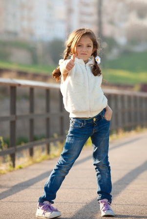 kids wear: child with thumb up for success