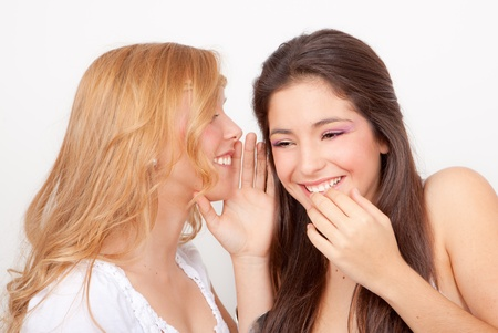 confide: teens whispering and gossiping