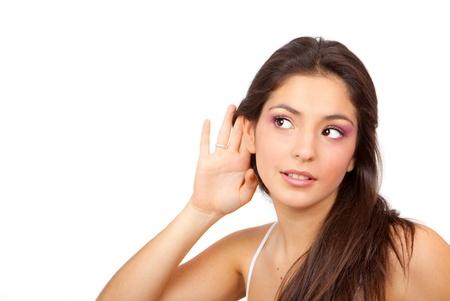 gossip: vrouw met holle de hand te luisteren naar roddels of geheime Stockfoto