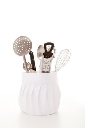 kitchen cooking equipment, chefs hat with utensils. photo