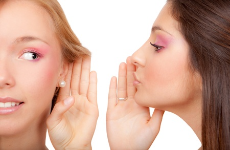 young women or teens whispering secrets scandal or gossip photo