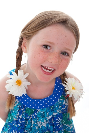 freckles: cute smiling little girl with braids or plaits and freckles