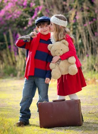 road of love: children kissing goodbye Stock Photo