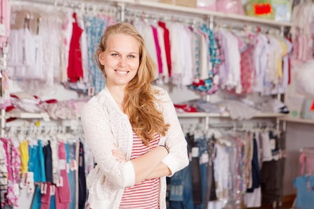 woman shopaholic in clothes shop photo