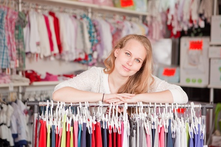 seller: woman shop assistant or retail seller. Stock Photo