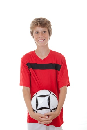 happy footballl or soccer player child holding ball photo