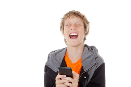 giggle: child laughing reading message on cell or mobile phone Stock Photo