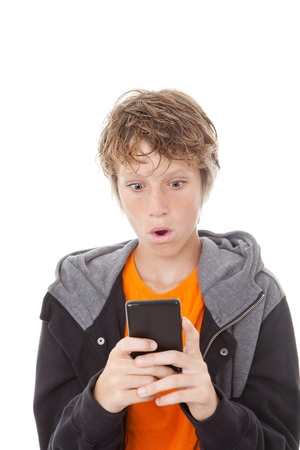 amazement: shocked kid reading message on mobile or cell phone