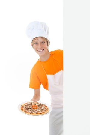happy kid serving pizza with copy space at side