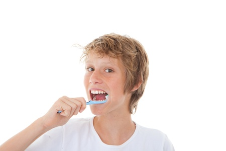 hygeine: healthy child cleaning teeth with tooth brush