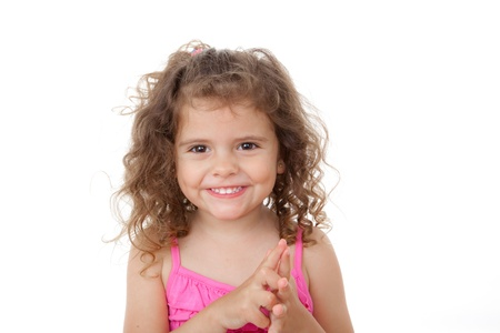 happy little girl kid with beautiful smiling face counting with fingers photo