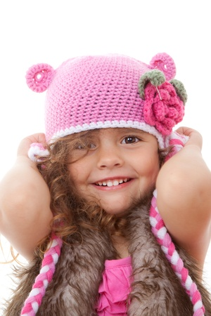 beautiful little girl smiling in knitted hat  Stockfoto