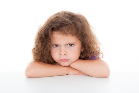 defiant: sulky angry young girl child, sulking and pouting,