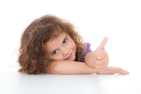 happy positive child with thumbs up for success Stock Photo - 13806489