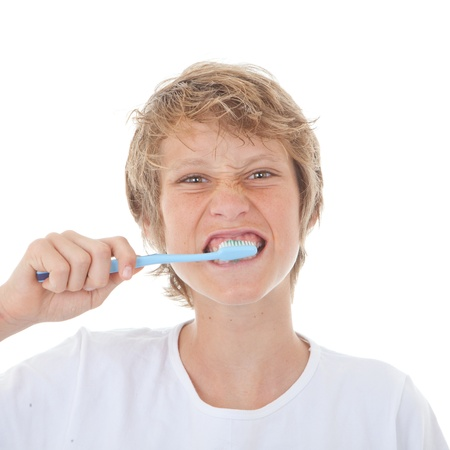 child brushing teeth with toothbrush and toothpaste