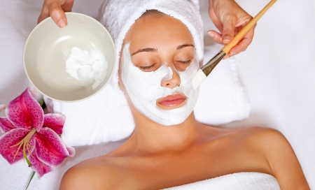 beauty parlour: woman at spa having relaxing face mask Stock Photo