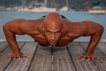 fit healthy strong man doing press ups outdoors. Stock Photo - 14738436