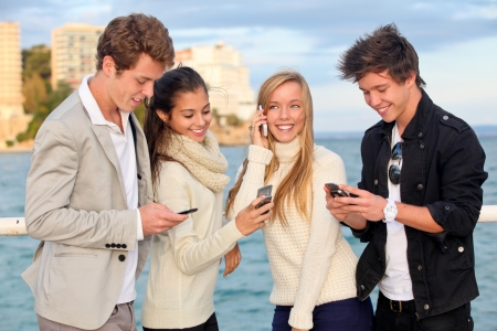 mobile telephones: young people or couples with cell or mobile phones  Stock Photo