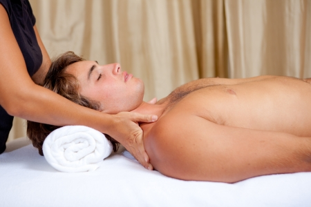 man getting relaxing massage at spa photo