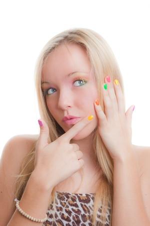 uñas pintadas: chica adolescente después de manicura con las uñas pintadas Foto de archivo