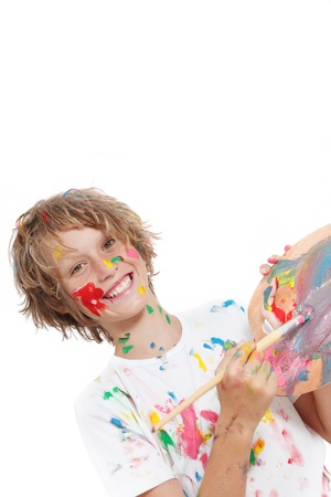 messy clothes: happy child or kid painting with paint and brush