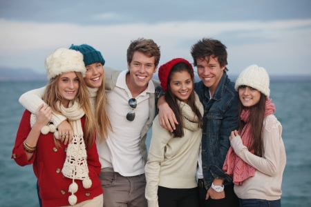 headwear: happy group of winter autumn teens Stock Photo