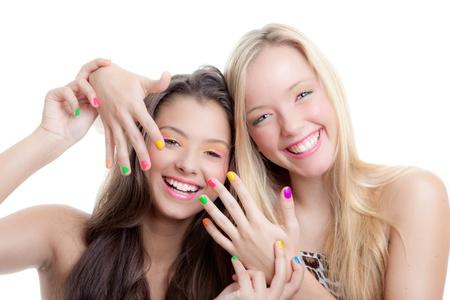 teens nails, young girls with bright make up and nail varnish Stockfoto