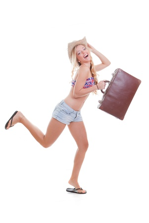 young woman with travel bag or case on summer holiday or spring break