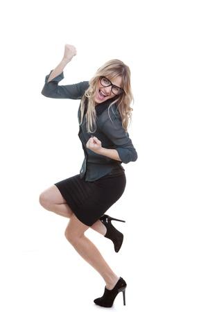 triumphant: business woman celebrating success triumphant gesture