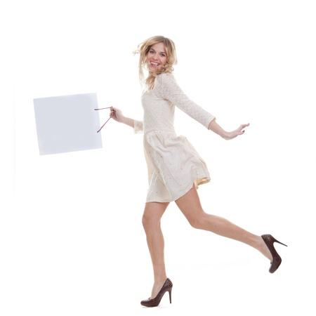 bargain: haoppy woman shopper holding shopping bag