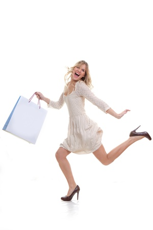 bargain: happy woman shopper hurrying for shopping sales concept