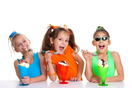 happy children eating icecream sundaes photo