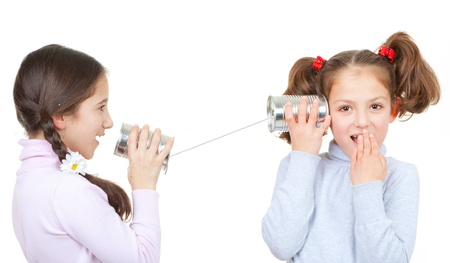 tin: kids playing with tin can and string phone as communication concept