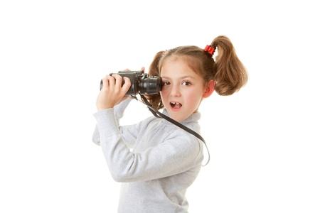 curious kid holding binoculars to spy Stock Photo - 17850749