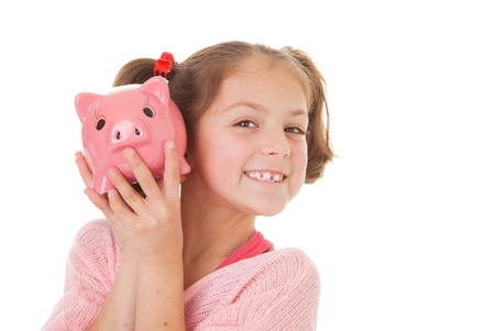 frugal: child with savings in piggy bank, banking concept