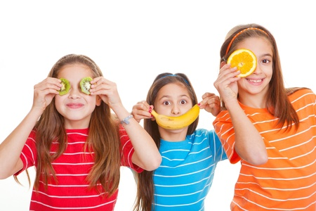 kids eating healthy: kids eating healthy fresh fruit diet concept Stock Photo