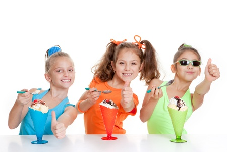 happy kids with thumbs up to eating icecream desserts