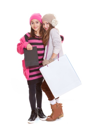 happy kids or young teens with shopping bags Stock Photo - 17850746