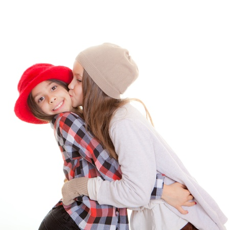 friendship friends or sisters giving kiss Stock Photo - 17850751